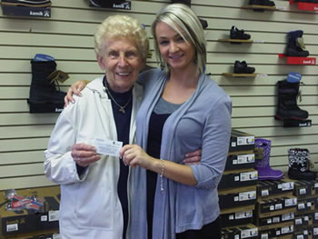 Winner of the $150.00 gift certificate at the grand opening of Shoe Villa in Elora